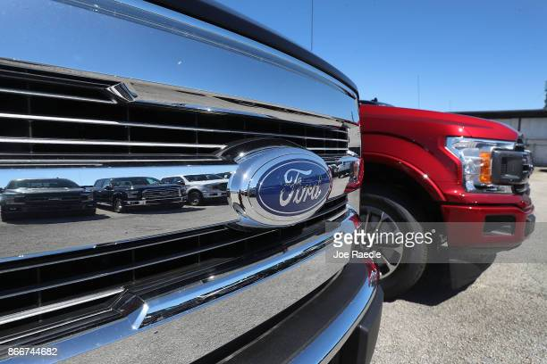 Ford F150 pickup trucks are seen on Metro Ford's sales lot on October 26 2017 in Miami Florida Ford reported it's quarterly earnings per share of 39...