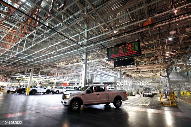 Ford F150 trucks come off the assembly line at the Ford Dearborn Truck Plant on September 27, 2018 in Dearborn, Michigan. The Ford Rouge Plant is...