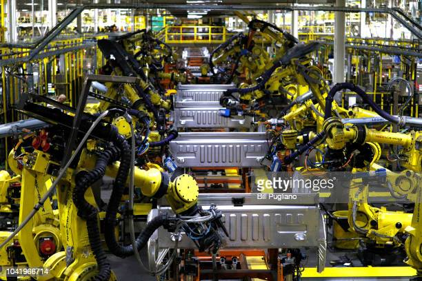 Ford F150 trucks go through robots on the assembly line at the Ford Dearborn Truck Plant on September 27, 2018 in Dearborn, Michigan. The Ford Rouge...