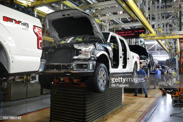 Ford F150 trucks go through the assembly line at the Ford Dearborn Truck Plant on September 27, 2018 in Dearborn, Michigan. The Ford Rouge Plant is...