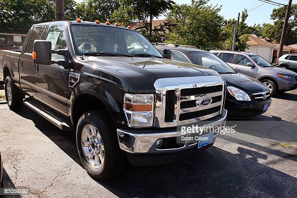 Ford F250 truck sits in a dealership's storage lot July 24, 2008 in Chicago, Illinois. Ford Motor Co. Today posted second quarter losses of $8.7...