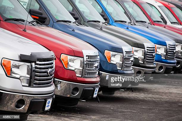 ford f-250 vehicles at a car dealership - ford motor company stock pictures, royalty-free photos & images