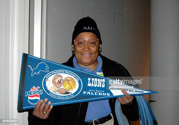 A Ford Field volunteer distributes banners commemorating the Thanksgiving Day game on November 24 2005 in Detroit Michigan