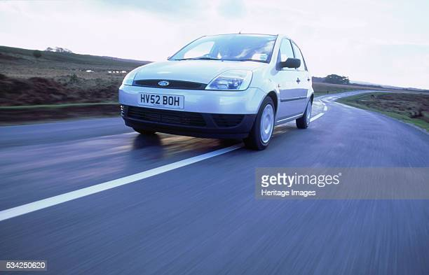Ford Fiesta driving along country road, 2000.