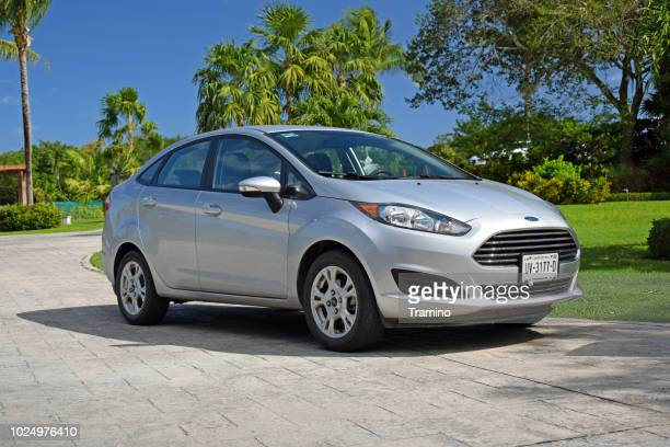 ford fiesta sedan on the street - ford motor company stock pictures, royalty-free photos & images