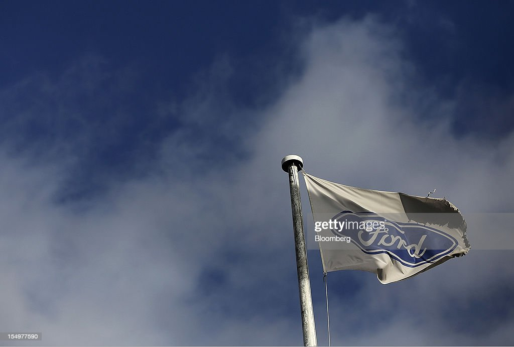 A Ford flag flies from a flagpole outside the stamping operations area at the Ford Motor Co. automobile factory in Dagenham, U.K., on Monday, Oct. 29, 2012. Ford Motor Co. will shut three European plants, its first factory closings in the region in a decade, and cut 5,700 jobs to stem losses that the carmaker predicts will total more than $3 billion over two years. Photographer: Simon Dawson/Bloomberg via Getty Images
