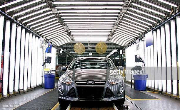 Ford Focus goes through quality inspection on the assembly line at Ford Motor Co's Michigan Assembly Plant December 14 2011 in Wayne Michigan Ford...