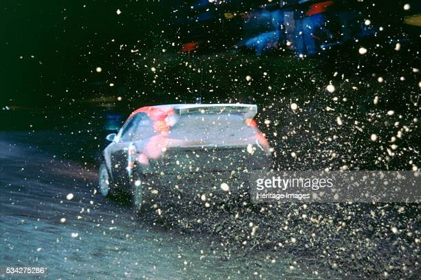 Ford Focus wrc driven by Colin Mcrae makes the mud fly on the Network Q rally 2000
