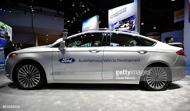 Ford Fusion hybrid autonomous development vehicle is displayed at the Ford booth at CES 2017 at the Las Vegas Convention Center on January 5 2017 in...