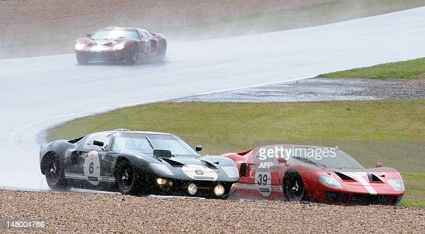 Ford GT 40 N°6 driven by New Zealand's Roger Wills competes ahead Ford GT 40 N° 39 driven by Portugal's Diogo Ferrao during the race devoted to cars...