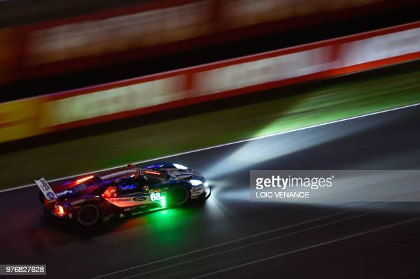 TOPSHOT Ford GT French driver Sebastien Bourdais competes during the 86th Le Mans 24hours endurance race at the Circuit de la Sarthe at night on June...