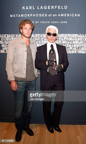 Ford model Brad Koenig and fashion designer and photographer Karl Lagerfeld arrive at the launch party for Lagerfeld's new book Metamorphoses of an...