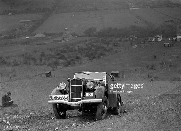 Ford Model C Ten competing in the London Motor Club Coventry Cup Trial Knatts Hill Kent 1938 Artist Bill BrunellFord 10 1172 cc Vehicle Reg No JG7785...