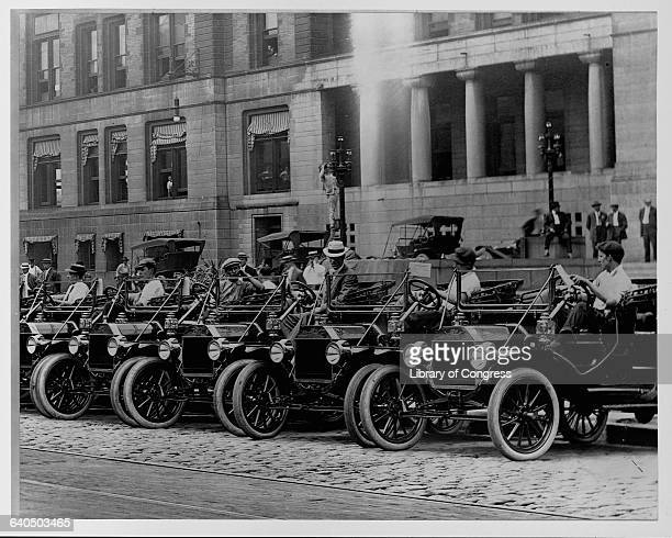 Ford Model Ts park in a row outside the city hall at St Louis Missouri ca 1920s