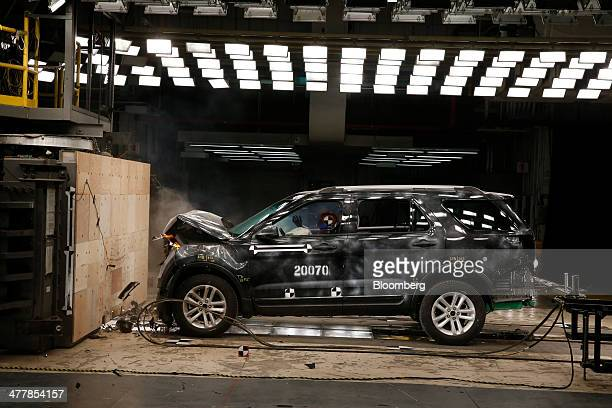 A Ford Motor Co 2014 Explorer XLT sits after a head on 30 mile per hour crash test at the company's Crash Barrier Facility and Safety Laboratory at...