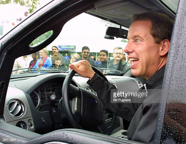 Ford Motor Co Chief Executive Bill Ford Jr greatgrandson of company founder Henry Ford gets behind the wheel of the 2004 F150 truck during opening...