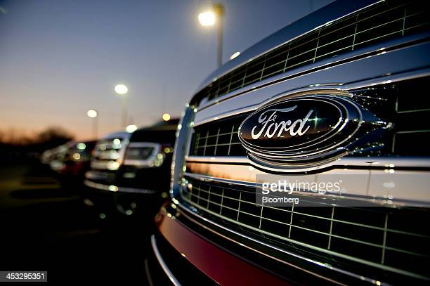 A Ford Motor Co emblem appears on the grille of a 2014 F150 pickup truck on display at Uftring Ford in East Peoria Illinois US on Saturday Nov 30...