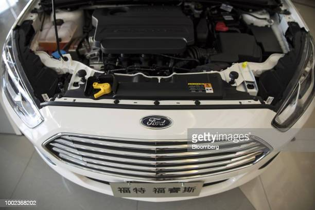 A Ford Motor Co Escort vehicle stands on display at a Ford dealership in Shanghai China on Thursday July 19 2018 The fledgling USChina trade war will...