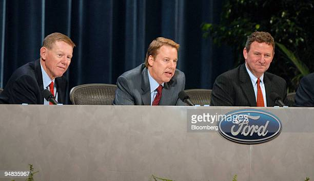 Ford Motor Co executives Alan Mulally president and chief executive officer left William Clay Ford Jr chairman and chief executive officer center and...