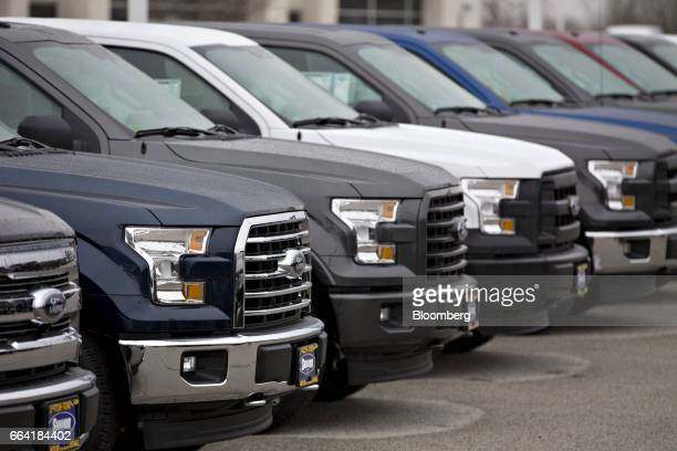 Ford Motor Co F150 pickup trucks sit on display at the Sutton Ford Lincoln car dealership in Matteson Illinois US on Monday April 3 2017 Ward's...
