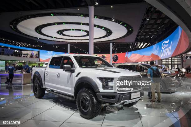 A Ford Motor Co F150 Raptor pick up truck stands on display at the Auto Shanghai 2017 vehicle show in Shanghai China on Wednesday April 19 2017...