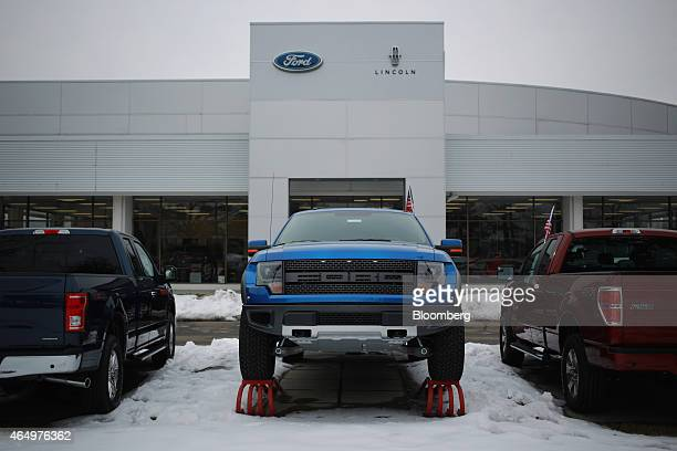 Ford Motor Co F150 Raptor truck center sits on display at the Oxmoor Ford car dealership in Louisville Kentucky US on Wednesday Feb 25 2015 Domestic...