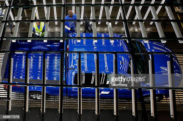 Ford Motor Co F150 truck moves through the inspection area on the production line at the company's Dearborn Truck Assembly facility in Dearborn...