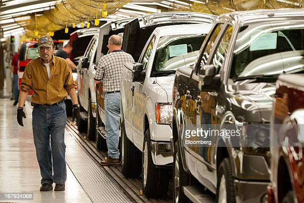Ford Motor Co F150 trucks move along the assembly line as employees work at the company's Kansas City Assembly Plant in Claycomo Missouri US on...