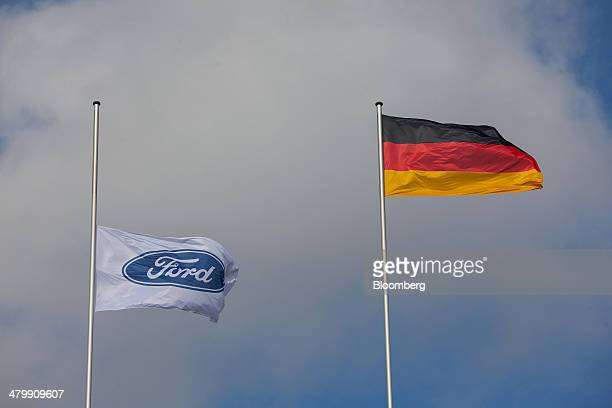 Ford Motor Co. Flag, left, flies at half mast following the recent death of Willliam Clay Ford, the last surviving grandchild of Ford founder Henry...