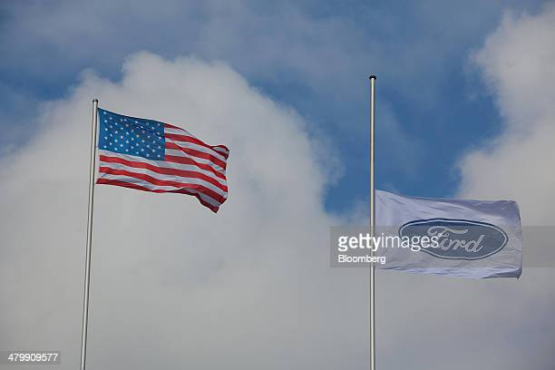 Ford Motor Co. Flag, right, flies at half mast following the recent death of Willliam Clay Ford, the last surviving grandchild of Ford founder Henry...