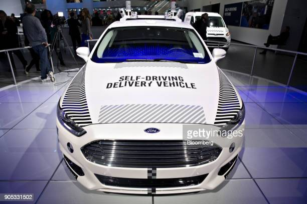 A Ford Motor Co Fusion setup as an experimental selfdriving delivery vehicle sits on display during the 2018 North American International Auto Show...