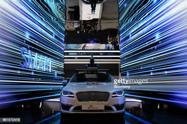A Ford Motor Co Lincoln MKZ vehicle using 5G technology is displayed at the SK Telecom Co booth at the World IT Show 2018 in Seoul South Korea on...