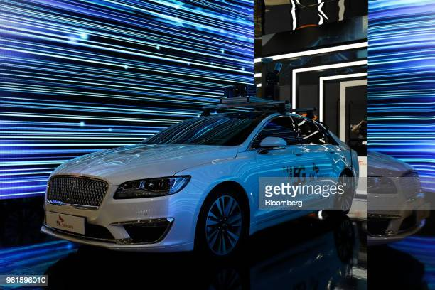 A Ford Motor Co Lincoln MKZ vehicle which uses 5G technology is displayed at the SK Telecom Co booth at the World IT Show 2018 in Seoul South Korea...