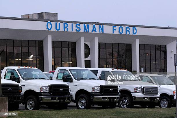Ford Motor Co vehicles sit on a dealership lot at Ourisman Ford in Bethesda Maryland Thursday Jan 25 2007 Ford Motor Co's fourthquarter loss widened...