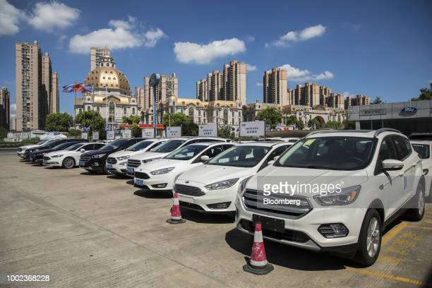 Ford Motor Co vehicles stand on display at a Ford dealership in Shanghai China on Thursday July 19 2018 The fledgling USChina trade war will take a...