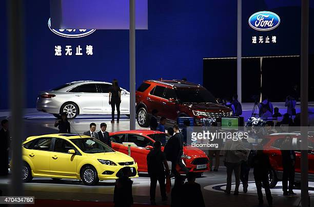 Ford Motor Co vehicles stand on display at the 16th Shanghai International Automobile Industry Exhibition in Shanghai China on Monday April 20 2015...