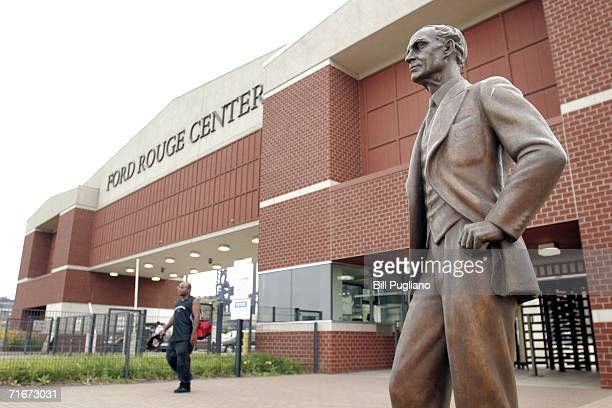Ford Motor Company employee leaves the Ford Dearborn Truck Assembly Plant at the end of his shift under the gaze of a statue of Ford founder Henry...