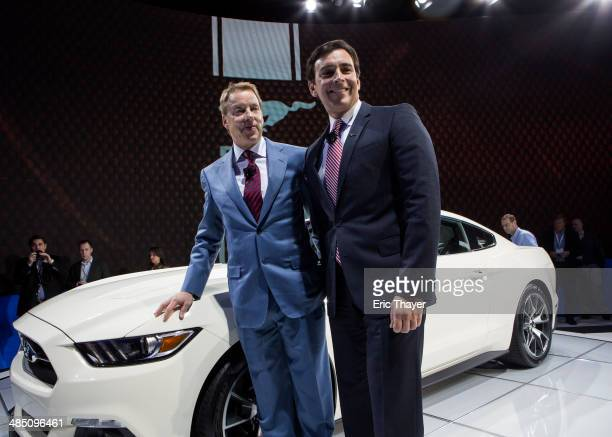 Ford Motor Company Executive Chairman Bill Ford and Chief Operating Officer Mark Fields pose for pictures next to the 50th anniversary Ford Mustang...