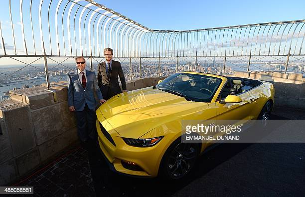 Ford Motor Company Executive Chairman Bill Ford and Empire State Realty Trust CEO Anthony Malkin pose as the 2015 Ford Mustang convertible is...