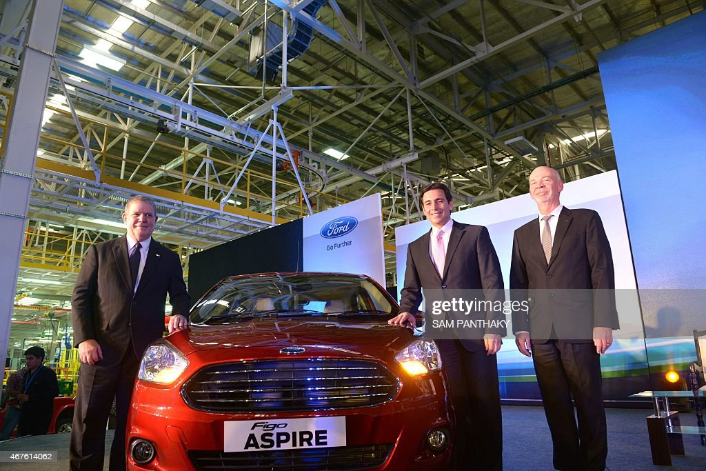 Ford Motor Company Global President and CEO, Mark Fields (C), Ford ...
