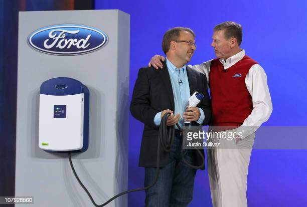 Ford Motor Company President and CEO Alan Mulally talks with Ford Manager of Global Electrification Infrastructure Mike Tinskey after demonstrating a...