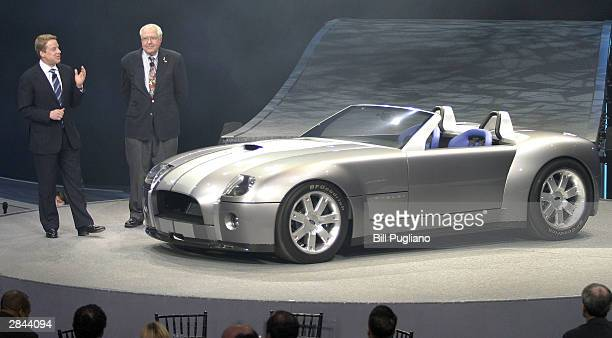 Ford Motor Company President and CEO William Clay Ford Jr talks with race car driver Carroll Shelby during the introduction of the new Ford Shelby...