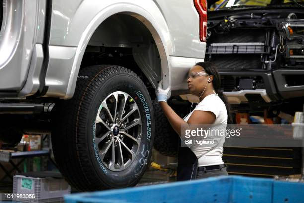 Ford Motor Company worker works on a Ford F150 truck on the assembly line at the Ford Dearborn Truck Plant on September 27 2018 in Dearborn Michigan...