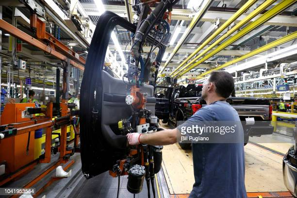 Ford Motor Company workers works on a Ford F150 truck on the assembly line at the Ford Dearborn Truck Plant on September 27 2018 in Dearborn Michigan...