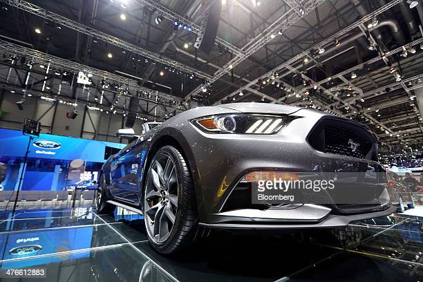 A Ford Mustang automobile produced by Ford Motor Co stands on display on the company's stand on the opening day of the 84th Geneva International...