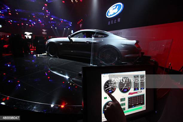 A Ford Mustang car is seen on display at the 50 years celebration ceremony of Ford Mustang in Beijing on April 19 ahead of the 'Auto China 2014'...
