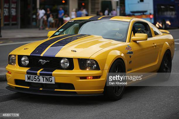 Ford Mustang drives through Knightsbridge on August 8 2014 in London England Tourists and car enthusiasts have been flocking to the wealthy London...