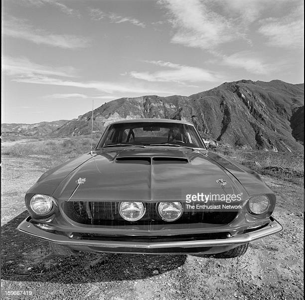 Ford Mustang Shelby GT500 Wide angle view of the front fascia showing dual driving lights in grille mountains in background