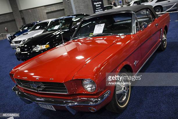 Ford Mustang with other classic cars on display at the 2015 Washington Auto Show in Washington DC on January 23 2015