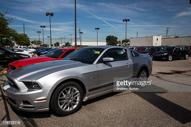 Ford Mustangs sit for sale at Bill Brown Ford Dealership on September 6 2013 in Livonia Michigan US auto giants had a good summer In August Ford had...